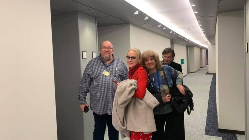 Антоанета Николова, в червено, чака заедно с колеги Гешев да излезе от срещата с евродепутати на 5 февруари. (Фейсбук профил на Антоанета Николова)